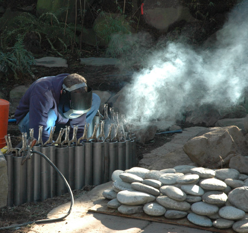 Employee working with welding equipment on jobsite