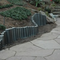 Stone path and steps with steel retaining wall